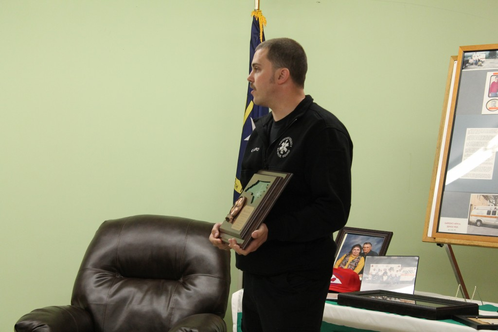 Lt. Gabe Burch Presenting Tom with Plaque